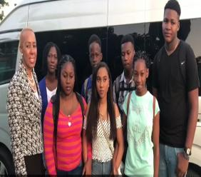 Eastern St Andrew Member of Parliament, Fayval Williams with the youths from Standpipe before they left for the United States last week.