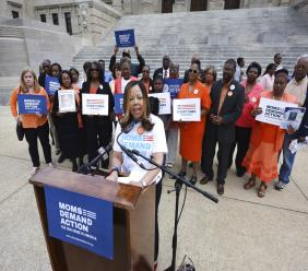 FILE - In this March 17, 2016, file photo, Lucy McBath, National Spokeswoman for Moms Demand Action for Gun Sense in America, is joined by faith leaders, gun violence survivors and others on the south steps of the Mississippi State Capitol in Jackson, Miss. There are nearly 50 black women running for Congress this year, from McBath who is challenging GOP Rep. Karen Handel in Georgia to Republican Rep. Mia Love's bid for a third term in Utah. (Joe Ellis/The Clarion-Ledger via AP, File)