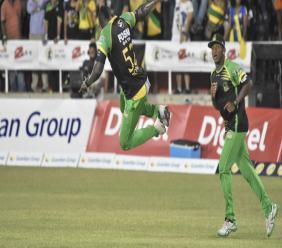 Jamaica Tallawahs batsman Rovman Powell (left) celebrates the fall of wicket during the Caribbean Premier League (CPL) match against St Kitts & Nevis Patriots at Sabina Park on Wednesday night. (PHOTO: Marlon Reid).