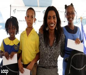 Verona Carter, VP, Public Affairs for New Fortress Energy, with students at last week's back to school fair in Old Harbour Bay, Clarendon. (PHOTOS: Ramon Lindsay)
