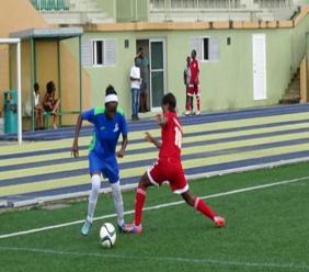 Shanice Stevenson (left) being tackled.