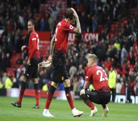 Manchester United's Chris Smalling, Victor Lindelof and Luke Shaw, from left to right, react at the end of the English Premier League football match against Wolverhampton Wanderers at Old Trafford stadium in Manchester, England, Saturday, Sept. 22, 2018. The game ended in a 1-1 draw.