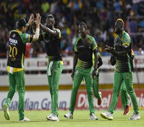 Jamaica Tallawahs players celebrate a wicket in a 2018 Caribbean Premier League game.