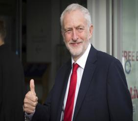 Britain's main opposition Labour Party leader Jeremy Corbyn gives a thumbs up gesture as he arrives for an interview by BBC TV journalist Andrew Marr, in Liverpool, England. (Stefan Rousseau/PA via AP)