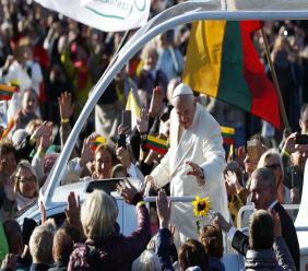 Pope Francis greets people as he arrives for a Mass at Santakos Park, in Kaunas, Lithuania. (AP Photo/Mindaugas Kulbis)