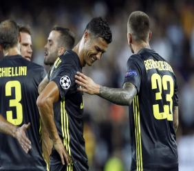 Juventus forward Cristiano Ronaldo is consoled by teammate Federico Bernardeschi, right, after receiving a red card during the Champions League, group H football match against Valencia, at the Mestalla stadium in Valencia, Spain, Wednesday, Sept. 19, 2018.
