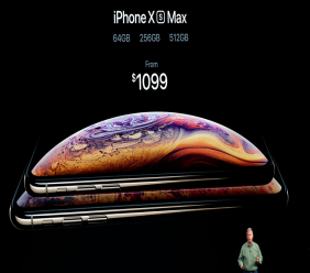 Phil Schiller, Apple's senior vice president of worldwide marketing, speaks about the new Apple iPhone XS Max at the Steve Jobs Theater during an event to announce new Apple products Wednesday, Sept. 12, 2018, in Cupertino, Calif. (AP Photo/Marcio Jose Sanchez)