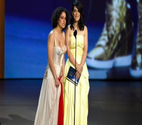 Ilana Glazer, left, and Abbi Jacobson present the award for outstanding writing for a variety special at the 70th Primetime Emmy Awards on Monday, Sept. 17, 2018, at the Microsoft Theater in Los Angeles. (Photo by Chris Pizzello/Invision/AP)