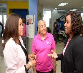 Carlene Edwards (right), Sales Promotions & Events Manager, JN Bank, converses with Yulit Gordon (left), Executive Director, Jamaica Cancer Society and Carolind Graham, Chairperson, Jamaica Reach to Recovery, during the recent launch of the JN Bank Power of Pink campaign.