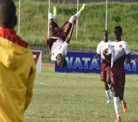 Dwayne Allen (left) of Wolmer's Boy celebrates his goal against Denham Town High with a somersault during their ISSA/Digicel Manning Cup return leg second round fixture at the Stadium East field on Friday, October 19, 2018. (PHOTOS: Marlon Reid).