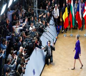 British Prime Minister Theresa May, right, arrives for an EU summit at the Europa building in Brussels, Thursday, Oct. 18, 2018. (AP Photo/Alastair Grant)