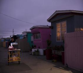 A food vendor passes through a mobile home park, where the majority of tenants are farm workers, in Salinas, California. (AP Photo/Jae C. Hong)