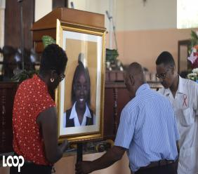 Kingston Technical High School administrators place a framed photo of the Yetanya Francis inside the Wildman Street Pentecostal Tabernacle as the school held a remembrance service for its late student in September.