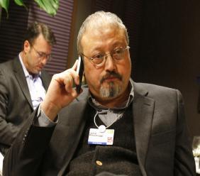 Saudi Arabian journalist Jamal Khashoggi speaks on his cellphone at the World Economic Forum in Davos, Switzerland. Saudi Arabia issued an unusually strong rebuke of the U.S. (AP Photo/Virginia Mayo, File)