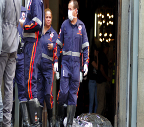 A firefighter walks next to a victim killed at the Metropolitan Cathedral in Campinas, Brazil, Tuesday, Dec.11, 2018. (Denny Cesare/Futura Press via AP)