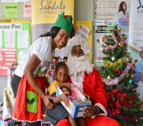 Sandals Foundation Montego Bay ambassadors Andre Campbell and Pauline Miller were in character at a Sandals Foundation Christmas Treat at Hague Infant School in Trelawny.