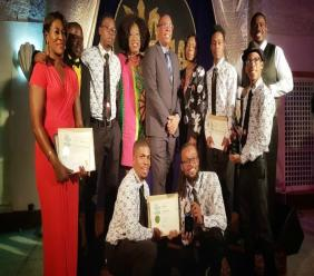 CEO of the NCF and Minister of Culture, John King (center) pose with some of the gold awardees.