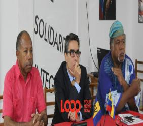(L-R) David Denny, General Secretary of the Friends of Venezuela Solidarity Committee; Avero Sanchez Cordero, Charge D'Affairs, Embassy of the Bolivarian Republic of Venezuela; Onkphra Wells, Chairman of the Pan African Coalition of Organizations.