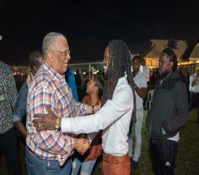 Opposition leader Dr Peter Phillips greets reggae singer Jesse Royal at Rebel Salute.