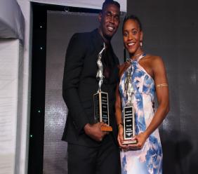 Fedrick Dacres (left) and Alia Atkinson pose with the Sportsman and Sportswoman of the Year awards at the gala ceremony at the Jamaica Pegasus Hotel on Friday, January 18, 2019. (PHOTOS: Llewellyn Wynter).