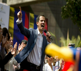 Juan Guaido, President of the Venezuelan National Assembly delivers a speech during a public session with opposition members, at a street in Caracas, Venezuela, Friday, Jan. 11, 2019. The head of Venezuela's opposition-run congress says that with the nation's backing he's ready to take on Nicolas Maduro's presidential powers and call new elections.(AP Photo/Fernando Llano)