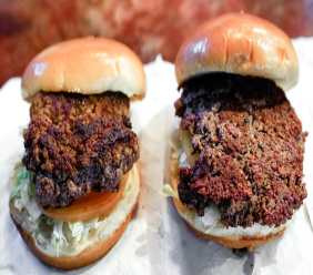 "A conventional beef burger, left, is seen Friday, Jan. 11, 2019, next to ""The Impossible Burger"", right, a plant-based burger containing wheat protein, coconut oil and potato protein among it's ingredients."