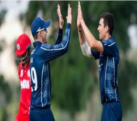 Scotland celebrate a wicket against Oman.