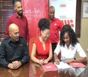 JMMB's Shani Duncan-Falconer (right) is seen here signing an agreement between JMMB Group and the Branson Centre of Entrepreneurship Caribbean. Looking on are: (L-R, front row) Jerome Smalling, CEO, JMMB Bank, Lisandra Rickards, CEO, Branson Centre and her colleague, Dmitri Dawkins alongside, Gregory Hines, JMMB Group chief business support officer.