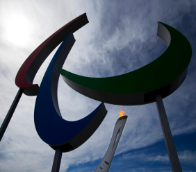 FILE - In this Sunday, March 16, 2014 file photo, the flame burns at the Olympic Park on the last day of the 2014 Winter Paralympics in Sochi, Russia. Russia will rejoin the Paralympics after a suspension of more than two years for widespread doping, the International Paralympic Committee said Friday Feb. 8, 2019. (AP Photo/Pavel Golovkin, File)