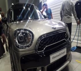 A man demonstrates the plug-in technology with the Mini Cooper Countryman at the Mini Showroom along Lady Musgrave Road in St Andrew on Thursday. (PHOTOS: Marlon Reid)