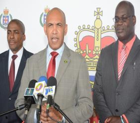 Deputy Commissioner Selvin Hay (left), the new Inspector General of the Jamaica Constabulary Force (JCF), pictured alongside Police Commissioner, Major General Antony Anderson (centre), and Assistant Commissioner Fitz Bailey. (file photo)