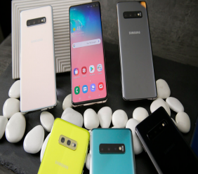 In this Tuesday, Feb. 19, 2019, photo are a selection of the new Samsung Galaxy S10 smartphones during a product preview in San Francisco. (AP Photo/Eric Risberg)