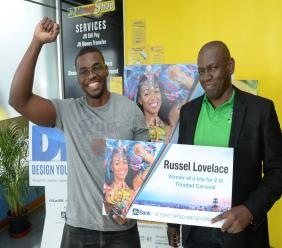 An elated Russel Lovelace (left) celebrates, as George Baker, Head of Credit Card Operations at JN Bank, presents him with the prize for an all-expense paid trip for two to Trinidad and Tobago Carnival under the Activate, Spend and Go Promotion.