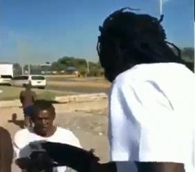 Screen grab of a video showing entertainer Buju Banton feeding the poor in Kingston.