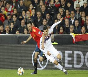 Spain's Sergio Busquets, left, challenges for the ball with Norway's Mohamed Elyounoussi during the Euro 2020 group F qualifying football match at the Mestalla stadium in Valencia, Spain, Saturday, March 23, 2019.