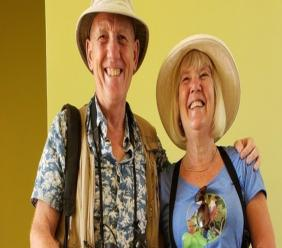 Geoff Cowley (left) and Marcelle Cowley outfitted in their birdwatching gear.