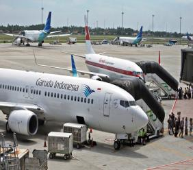 In this April 28, 2017, file photo, Garuda Indonesia planes are parked on the apron at the Soekarno-Hatta International Airport in Tangerang, Indonesia. (AP Photo/Dita Alangkara, File)
