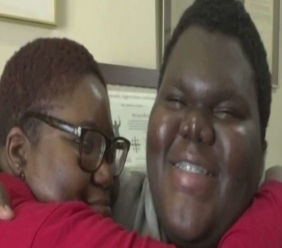 Dylan Chidick hugged by his mother as he tells of his acceptance into 17 universities. Photo taken from MSN.com