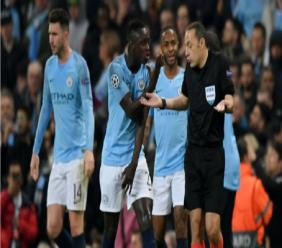Manchester City plead with referee Cuneyt Cakir against Tottenham.