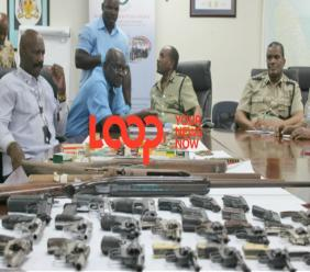 Senior police officials discuss the haul of weapons from the gun amnesty.