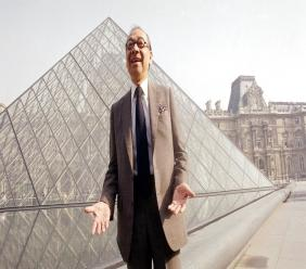 In this March 29, 1989, file photo, Chinese-American architect I.M. Pei laughs while posing for a portrait in front of the Louvre glass pyramid, which he designed, in the museum's Napoleon Courtyard, prior to its inauguration in Paris.  (AP Photo/Pierre Gleizes, File)