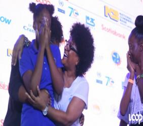 Bridget Lewis, co-founder of event organiser SheLeadsIT, embraces a member of the victorious STETHS team at the Caribbean Girls' Hackathon on Tuesday.