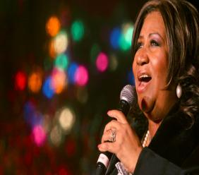 In this Dec. 4, 2008 file photo, Aretha Franklin performs during the 85th annual Christmas tree lighting at the New York Stock Exchange in New York. (AP Photo/Mary Altaffer, File)