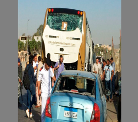 Police inspect a car and a bus that were damaged by a bomb, in Cairo, Egypt, Sunday, March 19, 2019. Egyptian officials say a roadside bomb has hit a tourist bus near the Giza Pyramids.