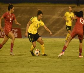 Reggae Girlz midfielder Mario Sweatman dribbles away from two Panama defenders during their international friendly match at the National Stadium on Sunday, May 19, 2019. Sweatman is one of 16 players from the squad selected for the game against Panama who will travel to the World Cup in France.
