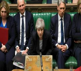 In this image made available by UK Parliament, Britain's Prime Minister Theresa May speaks during Prime Minister's Questions in the House of Commons, London, Wednesday, May 22, 2019. (Mark Duffy/UK Parliament via AP)