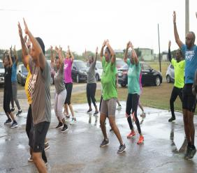 Employees of Jamaica Broilers engage in a cardio workout as they Commit To FIT