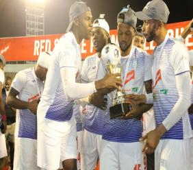 Portmore United's players display the Red Stripe Premier League trophy after beating Waterhouse 1-0 in the final on Monday, April 29, 2019 at the National Stadium.