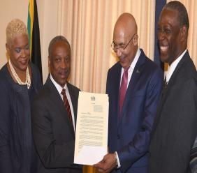 Governor-General, Sir Patrick Allen (second right) and Chairman of the Wolmer's Trust, Milton Samuda (second left), holding a proclamation officially designating May 21 as 'Wolmer's Day'. The event was held at King's House on Friday. Also pictured are Chairman of the Wolmer's Girls Sub-Committee, Karla Small-Dwyer (left) and Chairman of the Wolmer's Board of Management, Lincoln McIntyre. (PHOTO: JIS)
