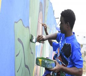 Pepsi engaged the services of students at the Edna Manley College for the Visual and Performing Arts to paint the mural, as part as the corporate company's Jamaica I Can campaign. (Photo: Marlon Reid)
